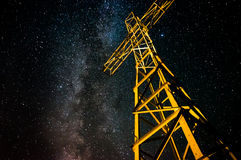 Lighted cross on starry night sky with milky way i Royalty Free Stock Image