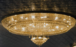 Lighted crystal chandelier Stock Images