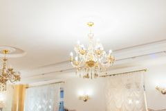 A lighted crystal chandelier under the white ceiling. For any purpose Stock Images