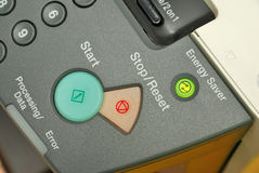 Lighted energy saving button on machine Stock Photography