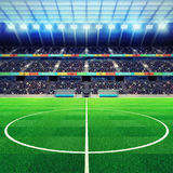 Lighted football stadium middle with fans in the stands Royalty Free Stock Photo