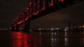 Lighted Footbridge Reflects Ohio River Louisville Kentucky Downtown. Footbridge takes pedestrians form Jeffersonville Indiana across the river to Louisville stock video footage