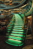 Lighted glass staircase in a cruise ship atrium. Modern neon lighted glass staircase in the atrium of a cruise ship Royalty Free Stock Photography