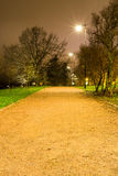 Lighted gravel path in the park Stock Photo