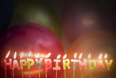 Lighted Happy Birthday Candles Stock Photography