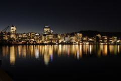 Lighted High-rise Building in Front of Body of Water Photo Royalty Free Stock Photography