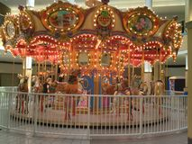 Lighted Horse Carousel In Mall Stock Images