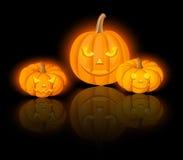 Lighted Jack-O-Lanterns (Halloween pumpkins). Vector eps-10. Vector illustration of three lighted Jack-O-Lanterns on a black background Royalty Free Stock Photography