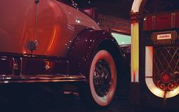 Lighted Jukebox Beside White and Brown Car Stock Images