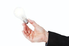 A lighted lamp in his hand. Stock Photography