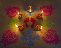 Lighted lamp with rangoli. Decoration of colorful rangoli with earthern lamps at Diwali Festival Stock Images
