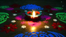 Lighted lamp with rangoli stock video