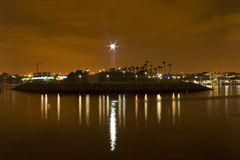 Lighted lighthouse Long Beach California. Wide shot of Lighthouse in Long Beach California at night with the glow of the pier in the background Royalty Free Stock Photo