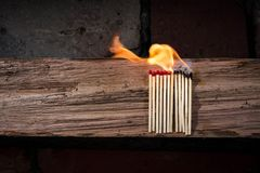 Lighted Matches on Brown Wooden Surface Stock Image