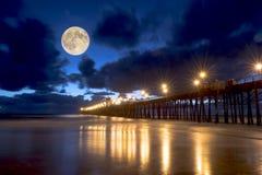 Lighted ocean pier nighttime Stock Photos