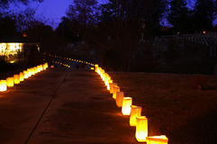 The lighted path. Path with candles royalty free stock photo