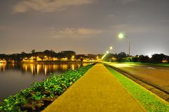 A lighted pathway in perspective by the water Royalty Free Stock Photo