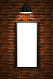 Lighted picture frame on a red brick wall royalty free stock photography