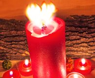 Lighted red candles. Heart shape of flame with lighted candles Royalty Free Stock Photo