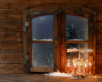 Lighted Red Candles on Stand at Window Pane Royalty Free Stock Image
