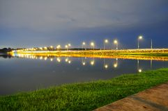 A Lighted road by Lower Seletar Reservoir Stock Images