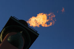 Lighted Rostral column. The flames on the Rostral column on background of the sky Stock Photo