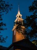 LIghted spire of Memorial Church, Harvard Yard, through summer e Royalty Free Stock Photo