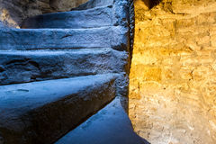 Lighted stone staircase in a castle Royalty Free Stock Image