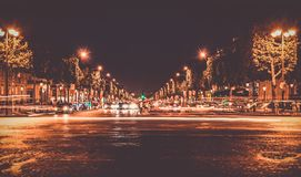 Lighted Street With Cars Passing by during Nighttime Royalty Free Stock Photos