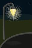 Lighted street lamp Stock Photos