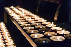 Lighted tea candles in a row royalty free stock image