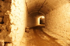 Lighted up corridor from a rough stone Royalty Free Stock Photos