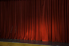 Lighted up red stage curtain Royalty Free Stock Photos
