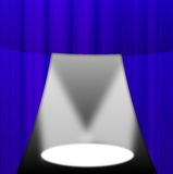 Lighted up stage with a blue portiere Stock Image