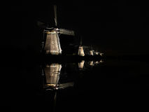 Lighted windmills in the black night Royalty Free Stock Photos