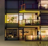 Lighted windows with balconies, typical city life in the Netherlands, Dutch architecture at night stock photography