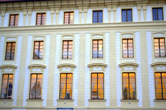 Lighted windows Prague Castle. Three storeys  of windows in the wall of the Prague castle,the seat of the Head of State,preparation for an official reception at Stock Photography
