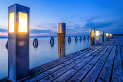 Lighted wooden pier Royalty Free Stock Photography