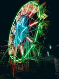 Lighten Ferris Wheel. This is a mini size of Ferris wheel, and sometimes people called it big wheel or observation wheel. It was stood in the dark night of a Royalty Free Stock Photography