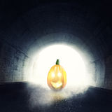 Lighten jack-o-lantern in front of darken tunnel with fog and li Royalty Free Stock Images
