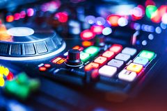 Lightened Audio Mixer Control Panel. Lightened Audio Control Panel with adjusted slide bar for DJ in night club. DJ professional sound mixer technology. Buttons stock photo