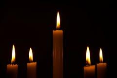 Lightened candles on dark background Stock Photo