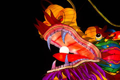 Lightened chinese dragon head. Colorful chinese lightened dragon head on a black background during a chinese light festival Royalty Free Stock Photos