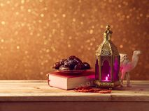 Lightened lantern and dates fruit Stock Image