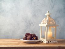 Lightened lantern and dates fruit Stock Images