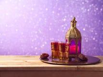 Lightened lantern, tea and dates fruit Royalty Free Stock Photos