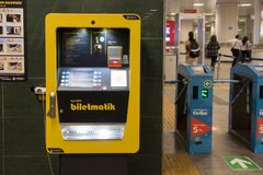 Lightened Metro Ticket Machine Stock Photo