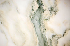 Lightened slices marble onyx. Horizontal image. Warm green colors. Beautiful close up background stock photography