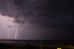 Lightening. In the distance on the ocean Royalty Free Stock Photo