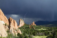 Lightening at The Garden of the Gods. A storm moves though Garden of the Gods park near Colorado Springs Colorado.  Lightening strikes nearby Stock Image